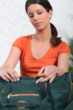 Woman packing travel bag Stock Image