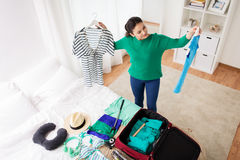 Woman packing travel bag at home or hotel room Stock Photo