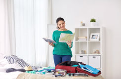 Woman packing travel bag at home or hotel room Royalty Free Stock Images