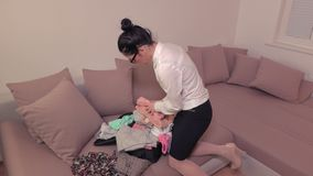 Woman packing travel suitcase at home. On room stock video