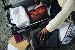 Woman packing for a trip royalty free stock photos