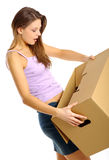Woman packing/unpacking boxes Royalty Free Stock Photography