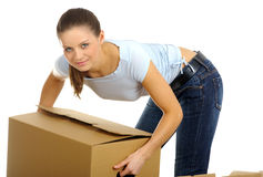 Woman packing/unpacking boxes Royalty Free Stock Photo