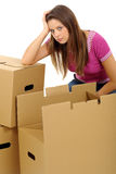 Woman packing/unpacking boxes stock images