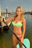 Woman on a Paddle Board Royalty Free Stock Photography