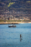 Woman paddle boarding in Redondo Beach Royalty Free Stock Image