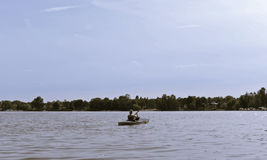 Woman in paddle boat. Young woman in paddle boat stock photos