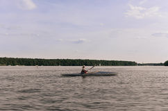 Woman in paddle boat. Young woman in paddle boat stock images