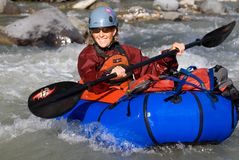 Woman Paddle in Packraft on McCarthy Creek Royalty Free Stock Photo