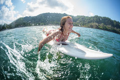 Woman paddle surfboard. With lots of splashes Stock Photography