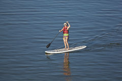 Woman paddleboarding Royalty Free Stock Images