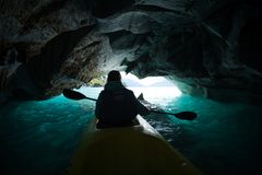 Woman paddles kayak. Inside the marble cave located on the General Carrera lake in Chile stock photos