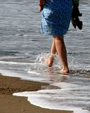 Woman paddling Stock Images