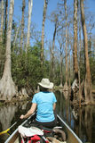 Woman Paddling a Canoe - Okefenokee Swamp Stock Photo
