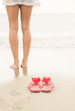 Woman paddling in the sea Royalty Free Stock Images
