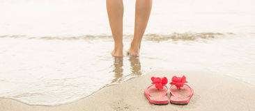 Woman paddling in the sea Royalty Free Stock Photos