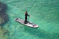Woman Paddling on SUP board royalty free stock photo