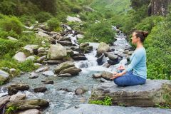 Woman in Padmasana outdoors Royalty Free Stock Images