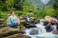Woman in Padmasana outdoors Stock Image