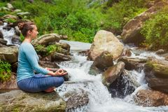 Woman in Padmasana outdoors stock images