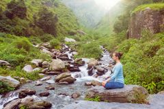 Woman in Padmasana outdoors Royalty Free Stock Photo