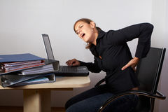 Woman in pain Stock Images