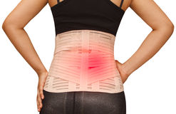 Woman in pain from back injury stock images