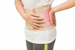 Woman in pain from back injury Stock Photos