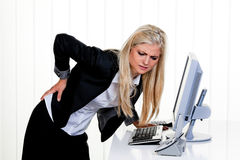 Woman with pain in the back office Royalty Free Stock Photos