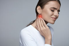 Woman In Pain. Beautiful Girl Feeling Toothache, Jaw, Neck Pain. Woman In Pain. Closeup Of Beautiful Young Female Feeling Painful Toothache, Touching Face With Stock Photos