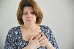 Woman with pain in  chest, angina Stock Images
