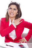 Woman with pain and discomfort at work Stock Photos