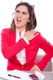 Woman with pain and discomfort at work. Woman expression of pain and discomfort at work Royalty Free Stock Photography