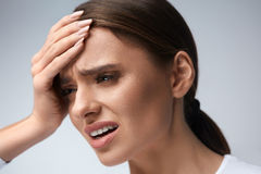 Woman Pain. Girl Having Strong Headache, Suffering From Migraine. Health. Woman In Pain Feeling Bad And Sick, Having Headache And Fever, Holding Hand On Forehead Royalty Free Stock Photos