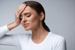 Woman Pain. Girl Having Strong Headache, Suffering From Migraine. Health. Woman In Pain Feeling Bad And Sick, Having Headache And Fever, Holding Hand On Forehead Royalty Free Stock Images