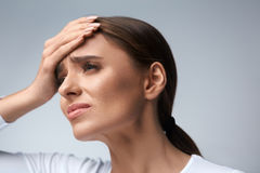 Woman Pain. Girl Having Strong Headache, Suffering From Migraine. Health. Woman In Pain Feeling Bad And Sick, Having Headache And Fever, Holding Hand On Forehead Royalty Free Stock Photo