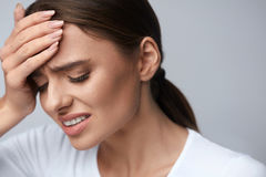Woman Pain. Girl Having Strong Headache, Suffering From Migraine. Health. Woman In Pain Feeling Bad And Sick, Having Headache And Fever, Holding Hand On Forehead Stock Photos