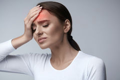 Woman Pain. Girl Having Strong Headache, Suffering From Migraine. Health. Woman In Pain Feeling Bad And Sick, Having Headache And Fever, Holding Hand On Forehead Stock Photography