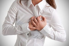 Woman in Pain. Woman having a pain in the heart area Royalty Free Stock Image