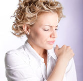 Woman with pain in her shoulder royalty free stock photos