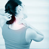 Woman pain in neck. Young brunette woman with a pain in the neck Royalty Free Stock Images
