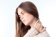 Woman with a pain in the neck. Young woman with a pain in the neck isolated on white background Royalty Free Stock Photos