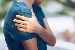 Woman with pain in shoulder and upper arm. Ache in human body stock photo