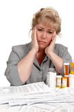 Woman pained by healthcare bills Royalty Free Stock Images