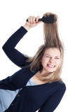Woman painful hairdressing using hairbrush Royalty Free Stock Images