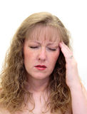 Woman with a painful headache Stock Photography