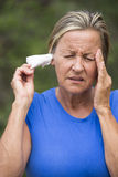 Woman painful headache tissue in ear stock photography