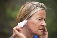 Woman painful migrane headache tissue in ear Royalty Free Stock Image
