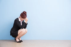 Woman is painful and squat royalty free stock photography