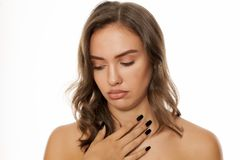 Woman with painful throat stock image